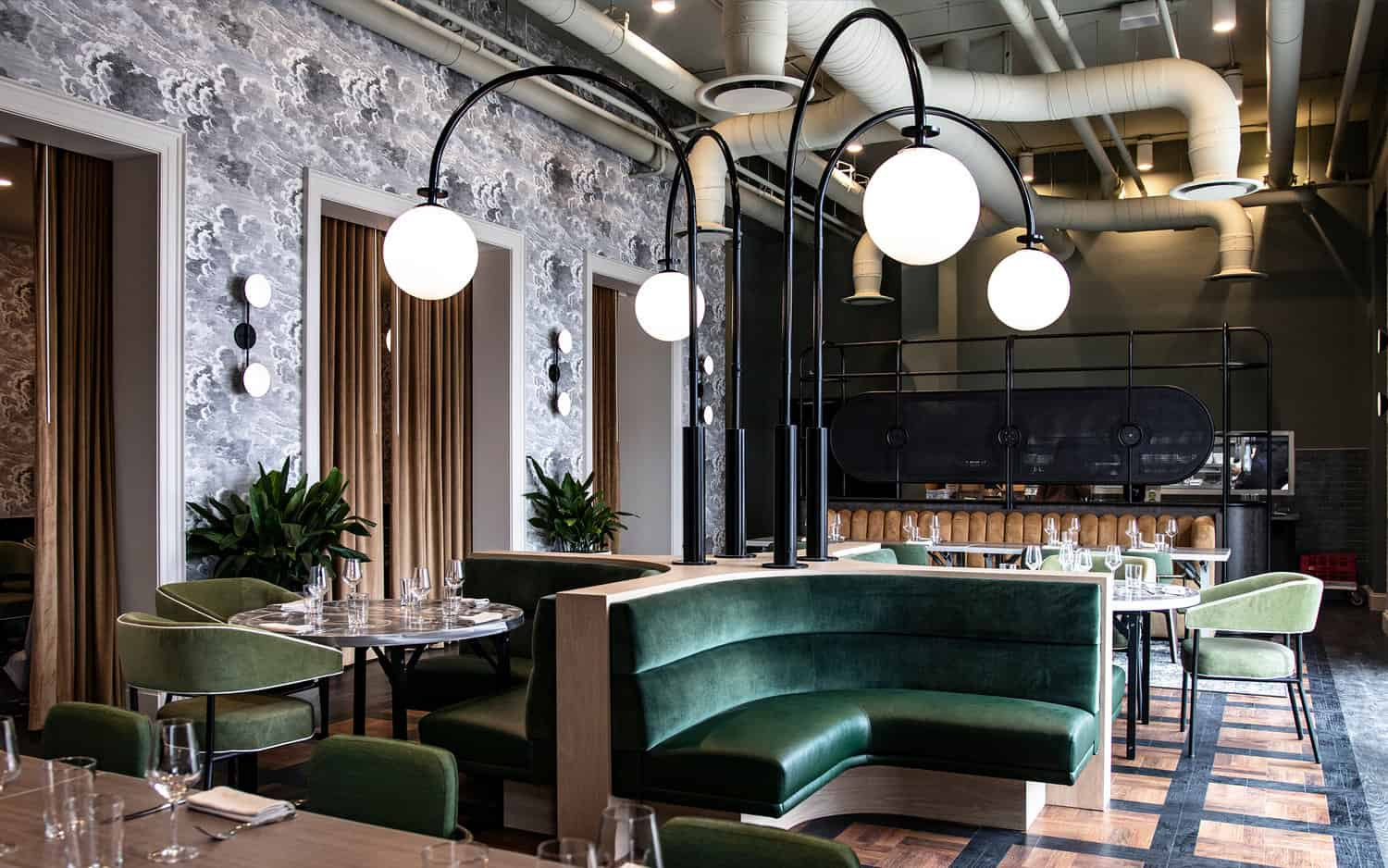 Dining room lighting with green sofas